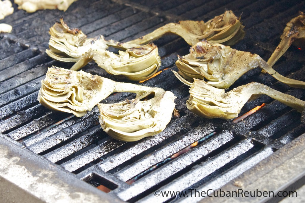 Artichokes kissed from the grill produce char marks with tons of flavor.