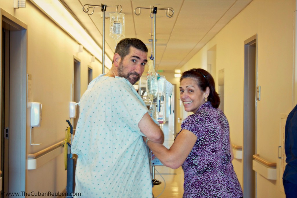 Mom and dad, reaching a recovery milestone by walking around the hospital floor.