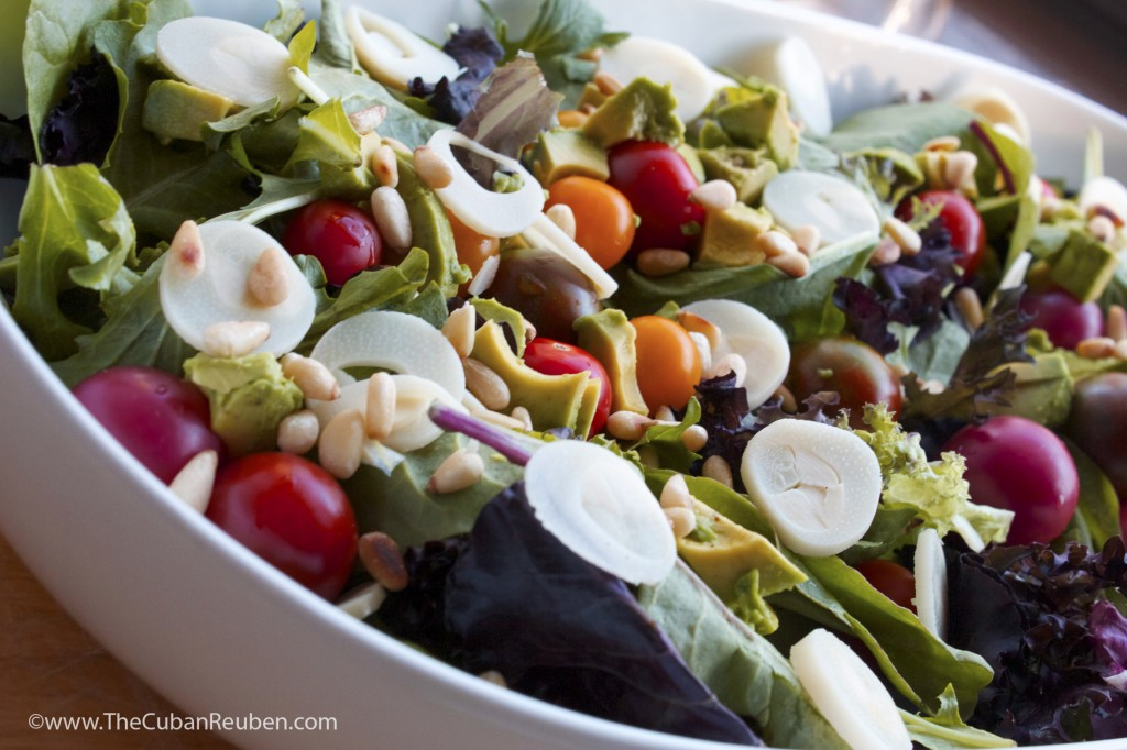 Pre-dressing, my salad included spring mix lettuce, sliced hearts of palm, cherry tomatoes, toasted pine nuts, and chunks of fresh avocado.