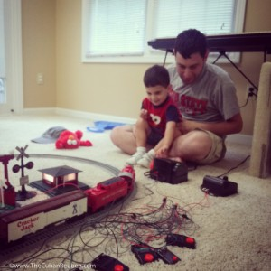 Uncle Ken shows Eli how to make the trains run. There may be another engineer in the family, soon!